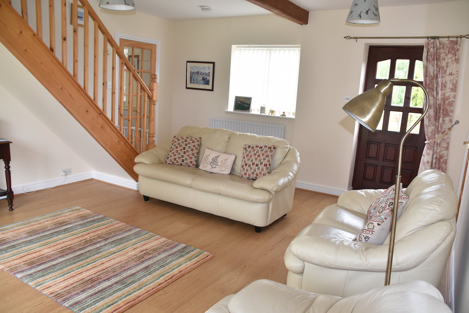 the saddle house - holiday cottage in boston lincolnshire, picture of our lounge area and door